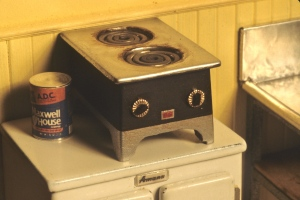 Coffee warmer. Hand-made by Noel, but the convincing detail is that readily-available coffee can to the left.