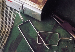 Wire framing and hammered screen mesh used for fryer baskets