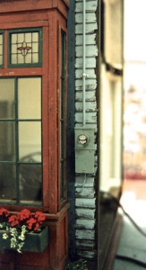 The photo shows the side of the miniature attached to a breakaway section of the building next door